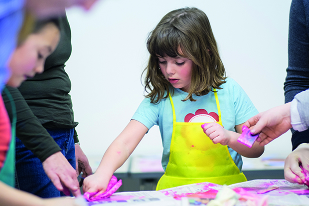 Young girl making craft