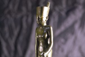 Portion of Neith, the patron goddess of Sais, bronze, Dynasty 26, about 600 B.C.