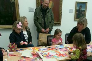 Family enjoying a craft session in The Art Box